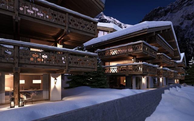 Alpesi házak esti fényben