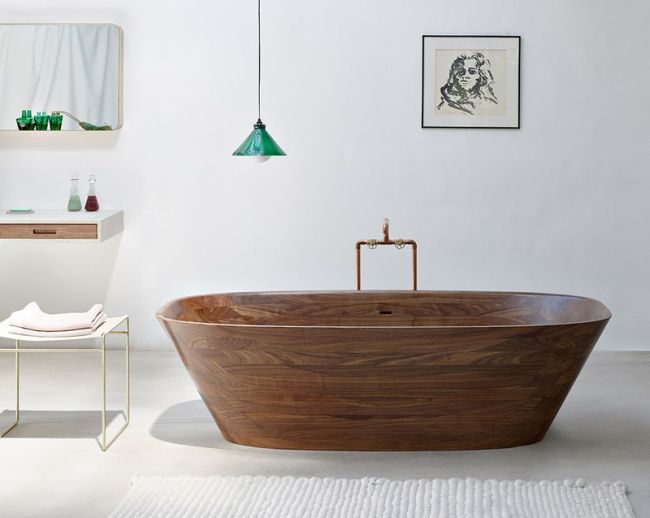Ovális térben álló design fürdőkád