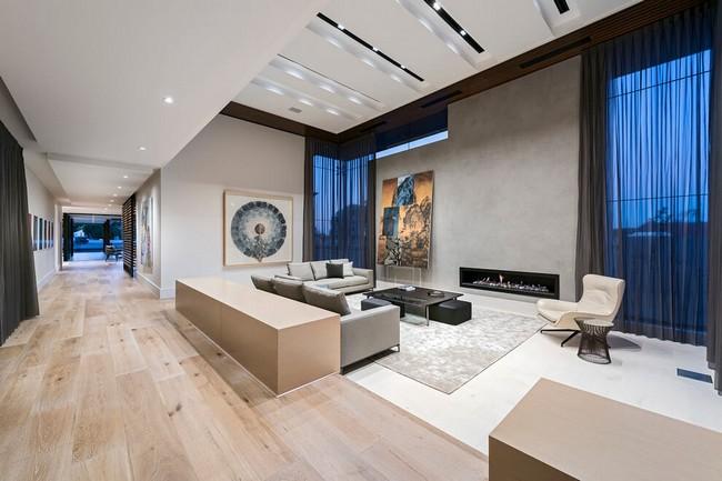 Nagy nappali, beton és üveg kombinációja
