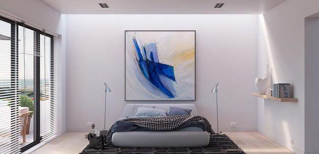 Világos minimál hálószoba egy nagy festménnyel