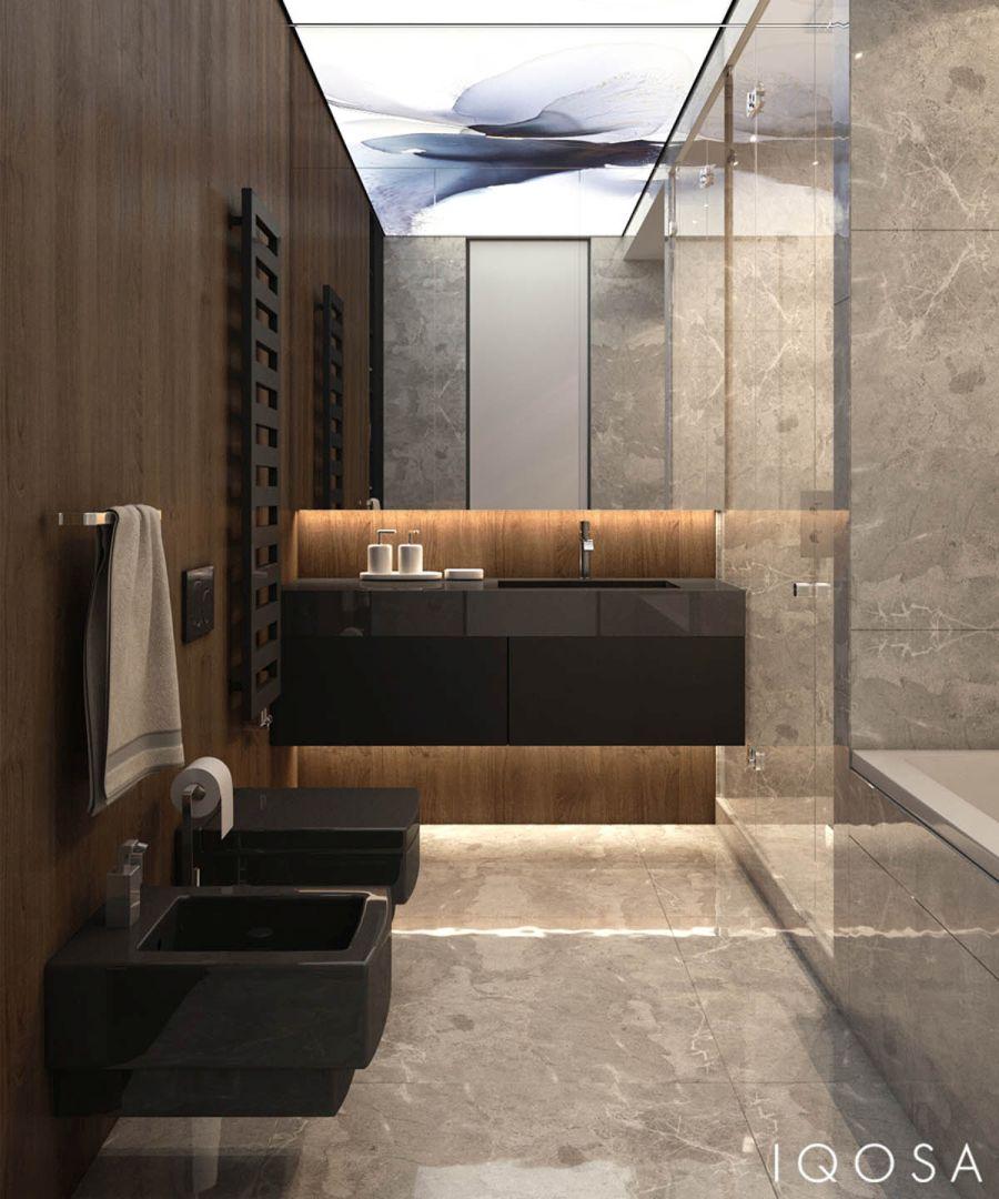 Fürdőszoba márvány falburkolattal és fekete szaniterekkel