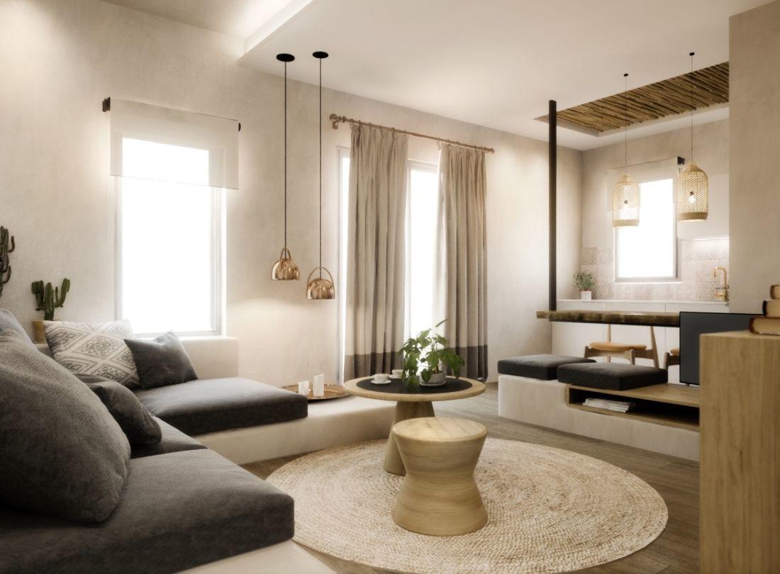 Modern mediterrán nappali sok fafelülettel és fonott kiegészítőkkel, falidíszekkel