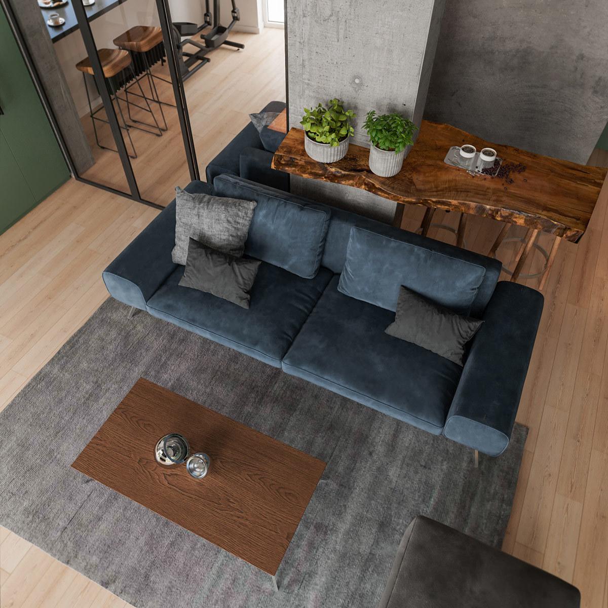 Szürke szőnyeg és egy puff is került a kanapé mellé