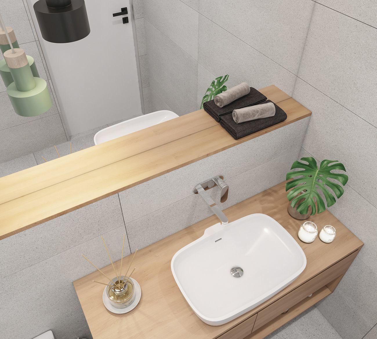 A világosszürke és natúr fa színek a fürdőszobában