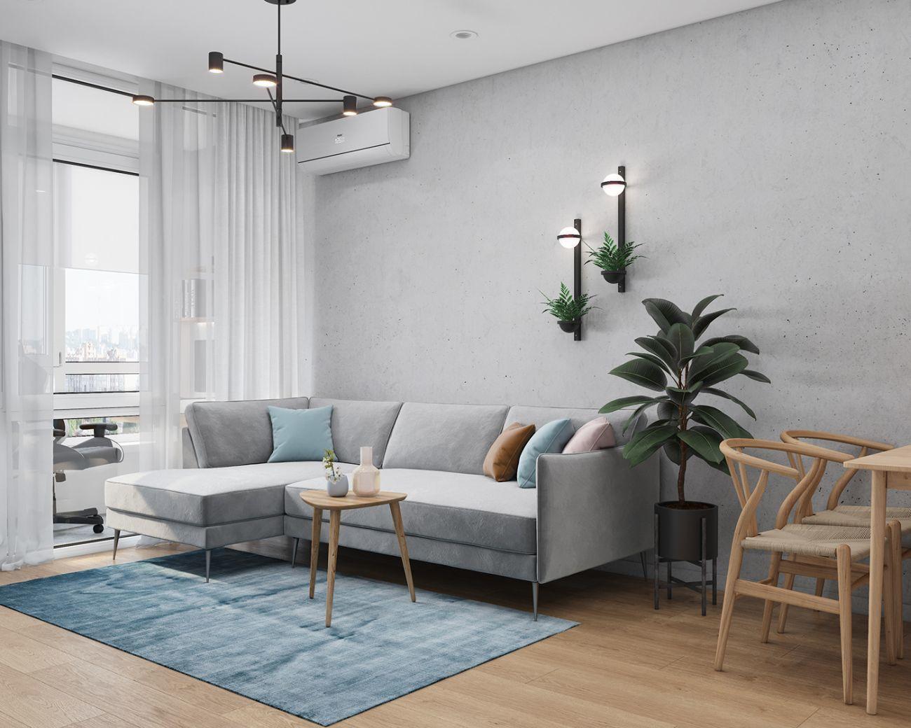 Beton design falak a panel hangulatához egy kényelmes kanapéval