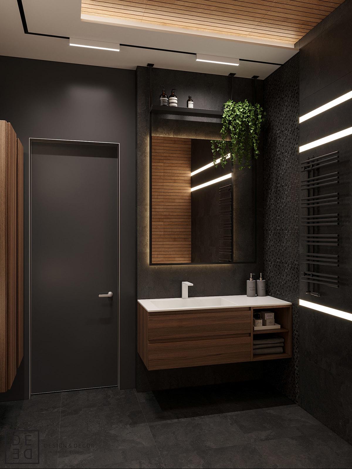Sötétszürke fürdőszoba és szépen megvilágított bútor