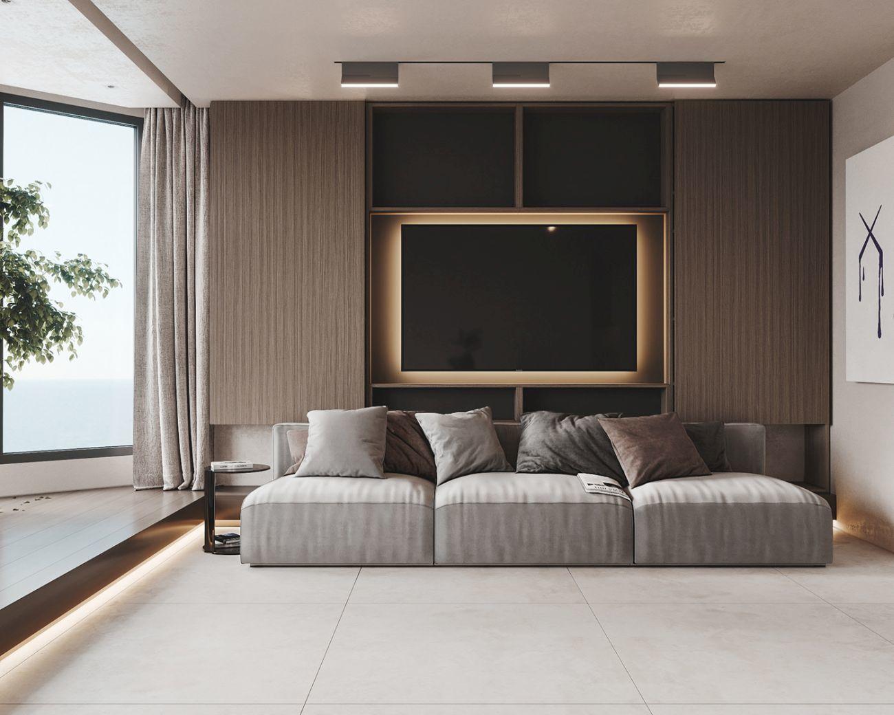 Kényelmes háromszemélyes kanapé - háttal a tévének