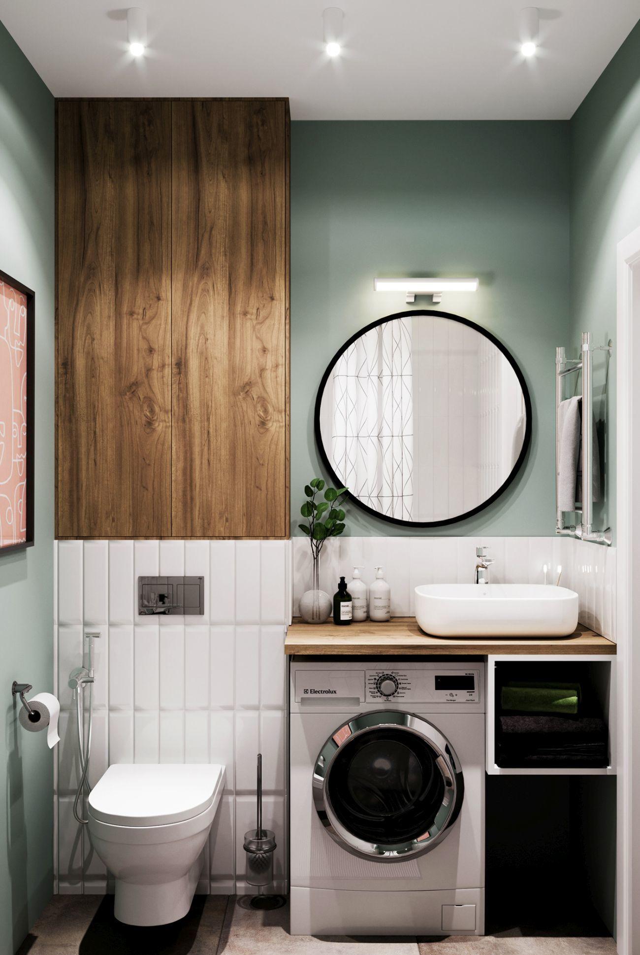 Kis fürdőszoba, ahol függőlegesen burkolták a fehér metró csempéket