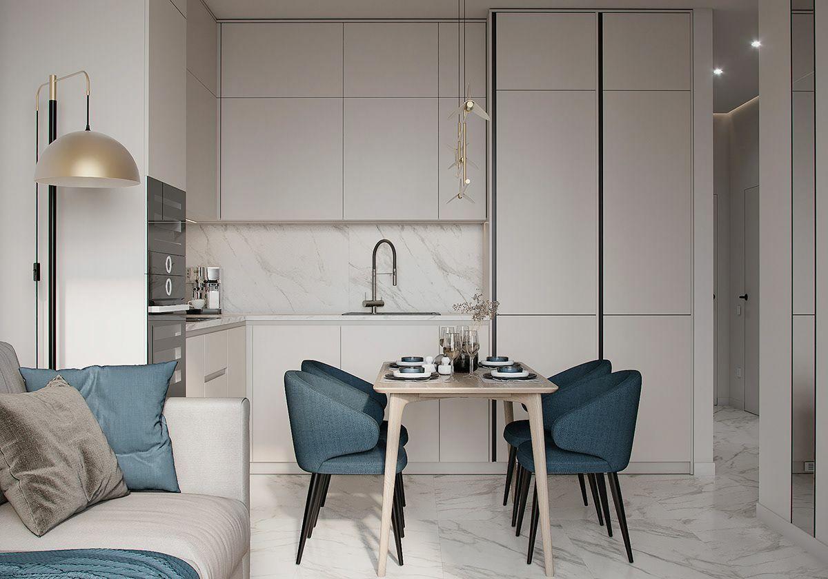 Világos konyhabútor és márvány mintás padlóburkolat világosítja a teret