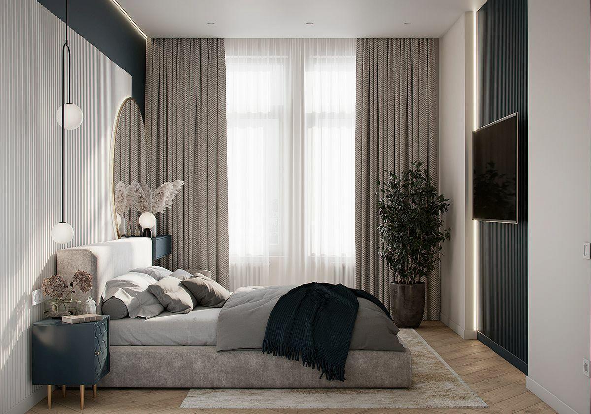 A kék szín a hálószobában is visszatér az éjjeliszekrény és a bordás faldekor formájában