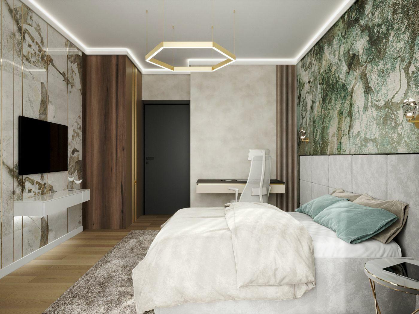 Kőmintás tapéta és faburkolatok teszik igényessé a helyiséget